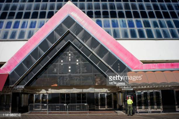 Man removes a poster of U.S. President Donald Trump at the shuttered Trump Plaza Hotel & Casino on October 18, 2019 in Atlantic City, New Jersey....