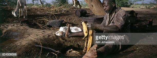 A man removes fur from a hide in Agadez in Niger | Location Agadez Niger