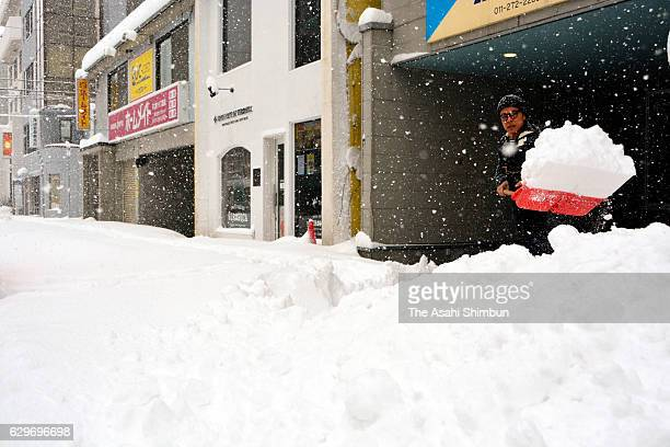 A man removes snow on the street on December 10 2016 in Sapporo Hokkaido Japan 65 centimetres of snowfall was recorded in central Sapporo