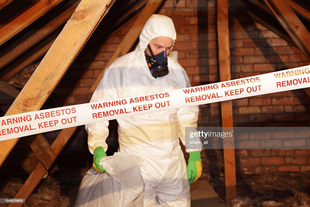 man removing asbestos : Stock Photo