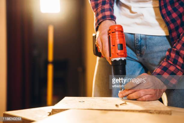 man renovate his new home - foundation make up stock pictures, royalty-free photos & images