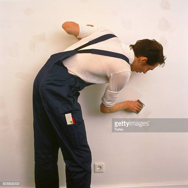 man renovating - man bending over from behind stock photos and pictures
