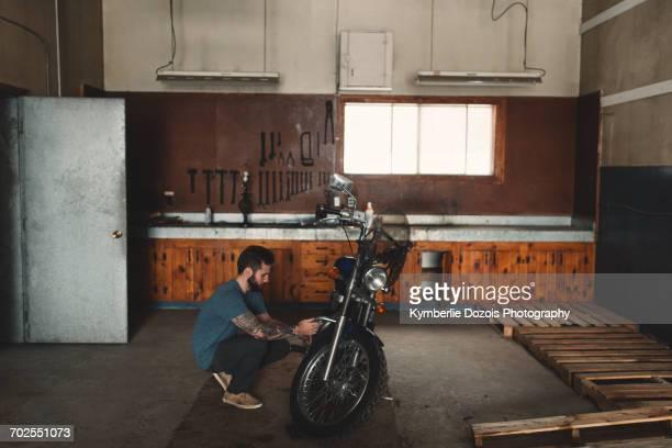 Man repairing bike in workshop