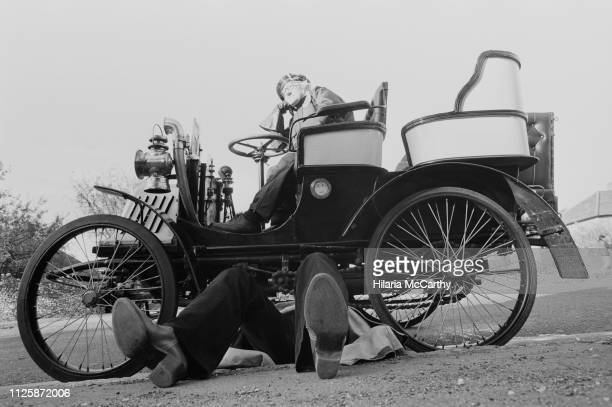 Man repairing his car at the London to Brighton Veteran Car Run, UK, 3rd November 1980.