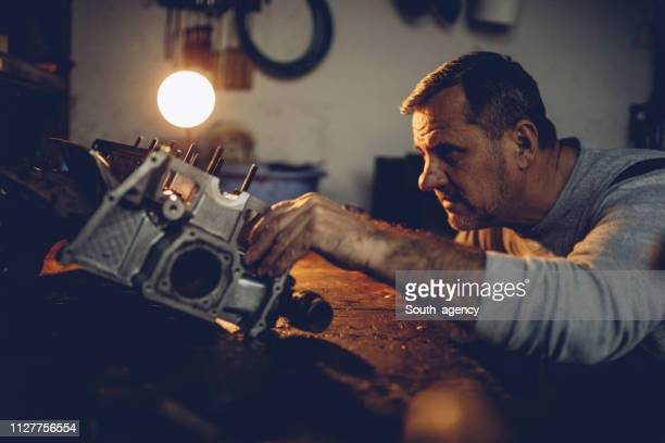 man repairing vehicle engine - south_agency stock pictures, royalty-free photos & images