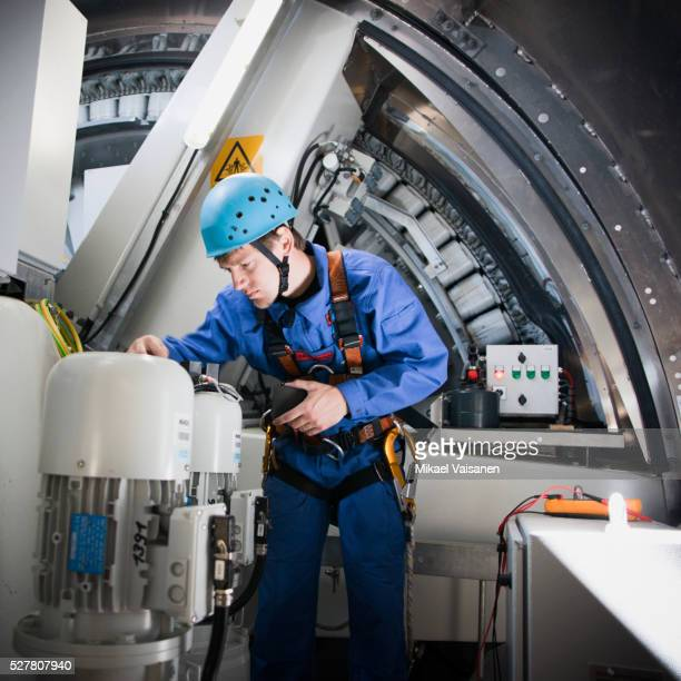 man repairing wind turbine - generator stock pictures, royalty-free photos & images