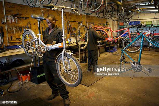 A man repairs a bicycle in a bicycle repair shop on September 29 2015 in Beira Mozambique
