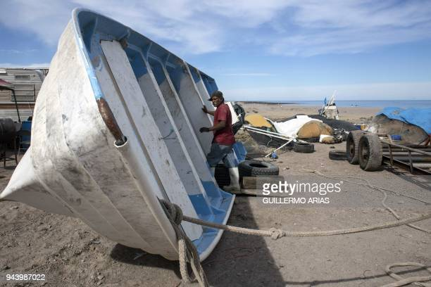 Man repairs a boat at Campo Serena fishing camp, in the Gulf of California, near Puertecitos, 90 kilometers south of San Felipe, Baja California...