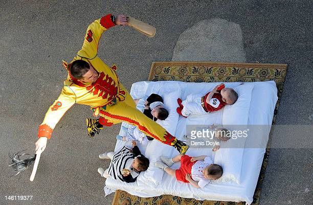 A man representing the devil leaps over babies during the festival of El Colacho on June 10 2012 in Castrillo de Murcia near Burgos Spain The...