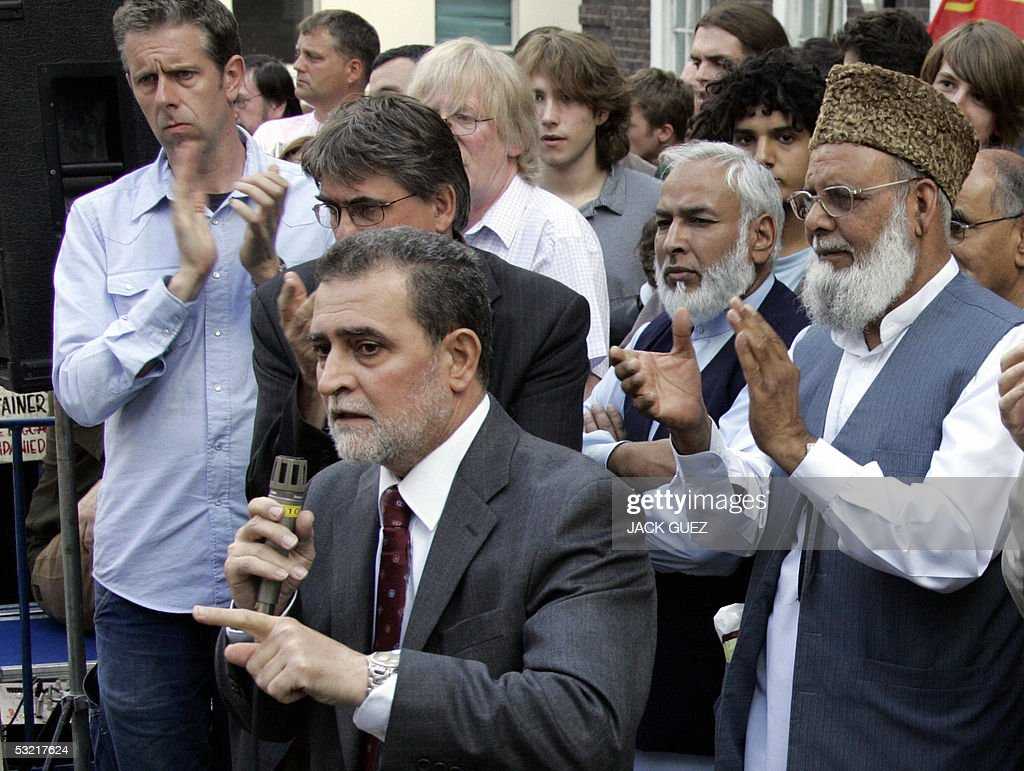 A man (no names) representing the Muslim community in London speaks during a gathering 09 July 2005 to remember the victims of the London bombings that killed at least 50 people and injured some 700. The three bombs placed in packed London Underground trains exploded seconds apart, police said Saturday, revealing a chillingly precise attack by suspected Al-Qaeda fanatics.