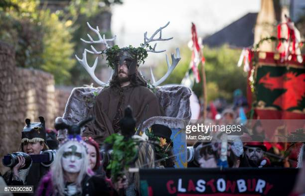A man representing the Winter King is paraded through the town as he takes part in a ceremony as they celebrate Samhain at the Glastonbury Dragons...