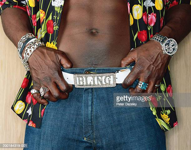 man resting hands on belt with diamonte buckle, close-up - bling bling stock pictures, royalty-free photos & images