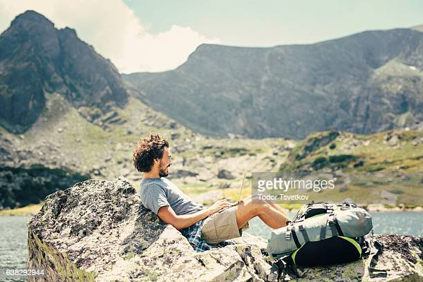 Man resting in the mountain