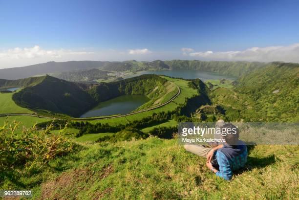 man resting near sete cidades lakes, sao miguel island, azores, atlantic ocean, portugal - ponta delgada stock photos and pictures
