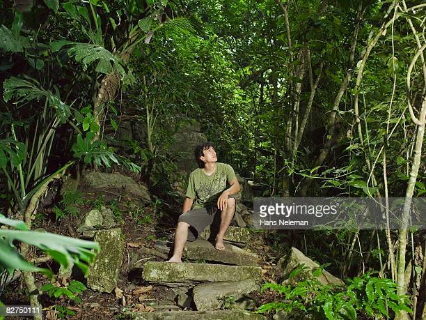 man resting on a staircase in the forest - las posas stock pictures, royalty-free photos & images