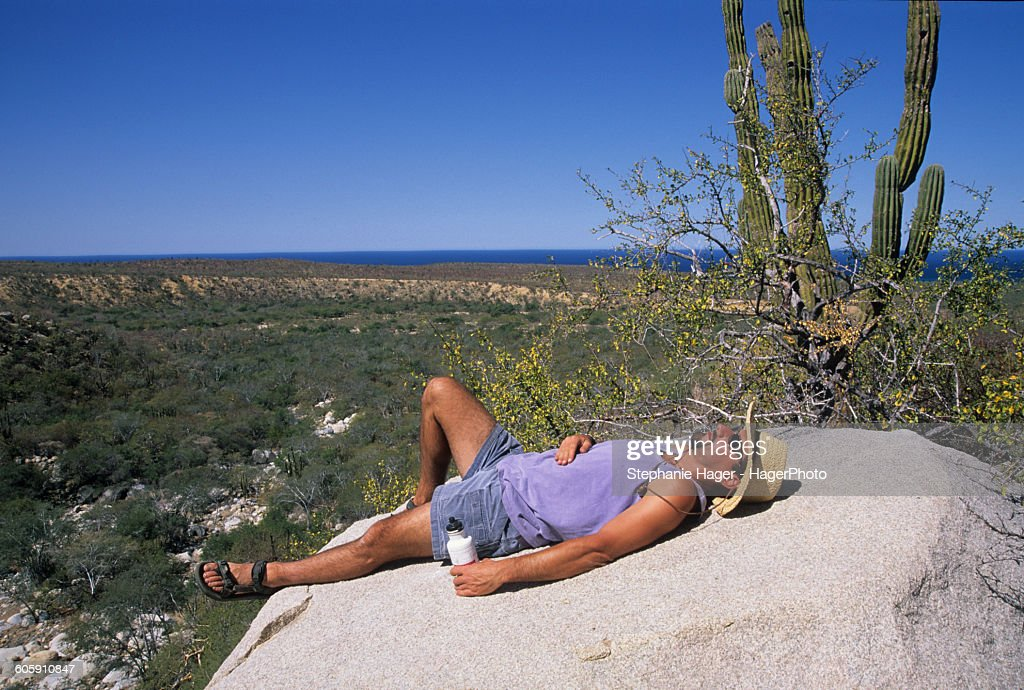Man resting on rock : Stock Photo