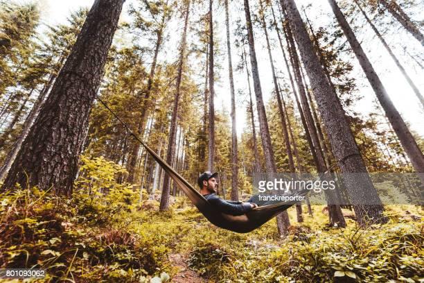man resting on the hammock