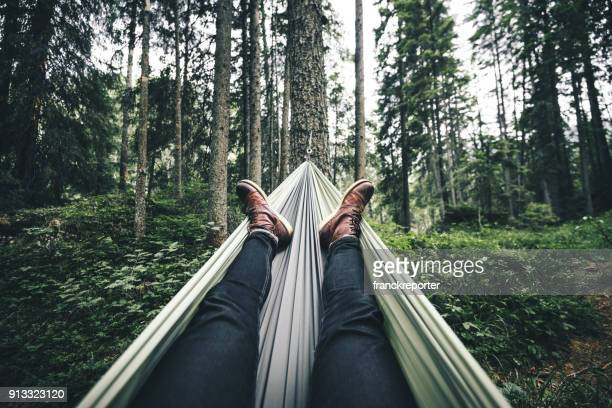 man resting on the hammock