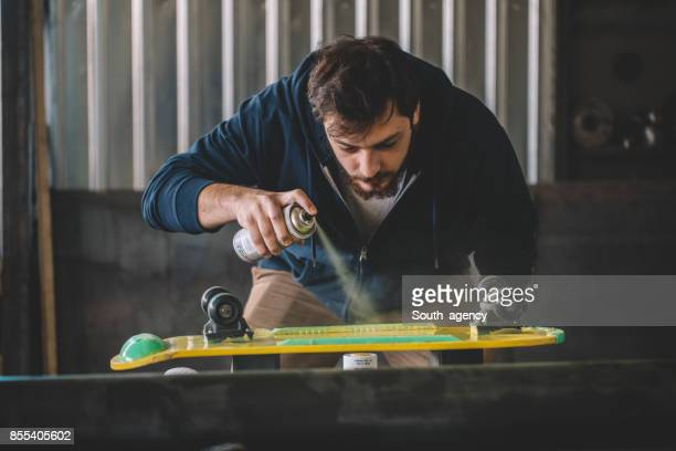 man restoring old skate - spray paint stock pictures, royalty-free photos & images