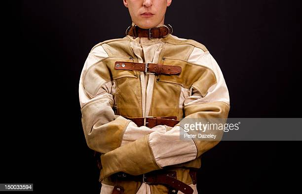 a man restrained in a straight jacket - straight jacket stock pictures, royalty-free photos & images
