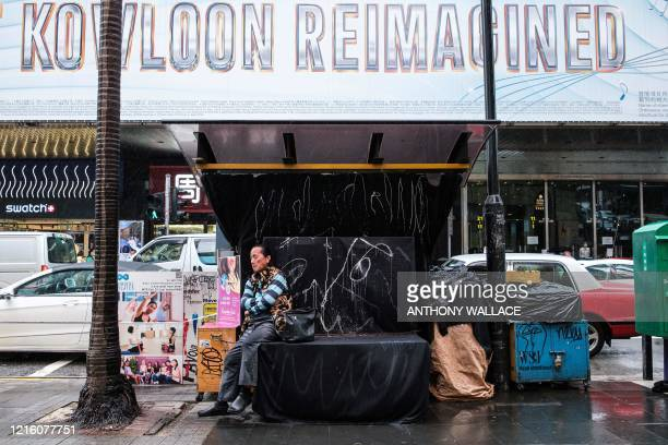 A man rests at a closed newspaper and magazine street stall in Hong Kong on May 29 2020 China faced growing international pressure May 29 over its...