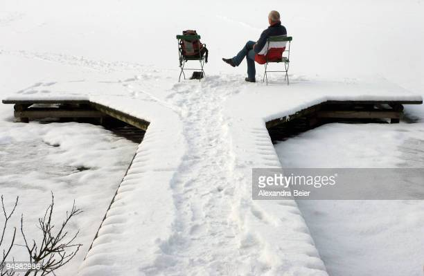 A man rests at the Wessling lake on December 21 2009 in Wessling Germany Heavy snowfall hit Bavaria