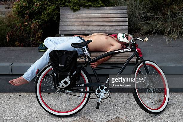 Man rests by his bike at the South Street Seaport, August 15, 2016 in New York City. The New York City area is once again under a heat advisory on...