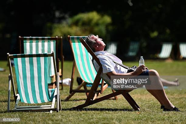 A man rests in a deck chair in central London on July 18 2014 as parts of the country were expected to experience the hottest day of the year so far...