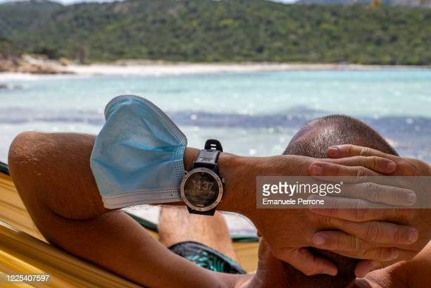 A man rests in a hammock on the last day of restrictions on May 17 2020 in Porto Cervo Sardegna Italy Italy was the first country to impose a...