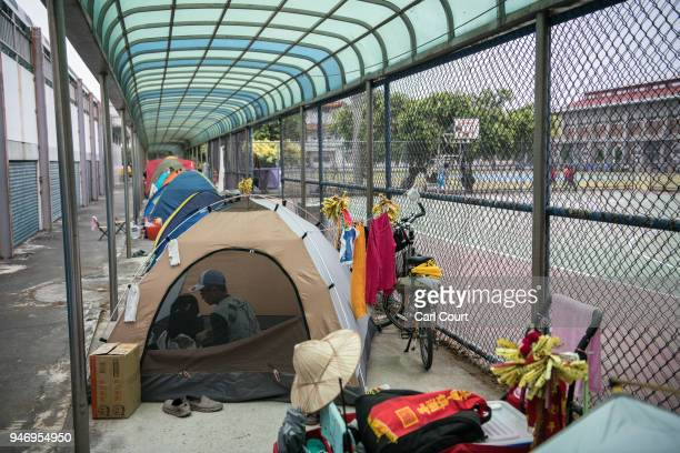 A man rests in his tent pitched in a school near Xingang Fengtian Temple that has been allocated for pilgrims who are following the statue of Mazu on...