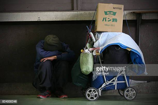 A man rests next to his belongings in the slum area of Kamagasaki on April 23 2016 in Osaka Japan Kamagasaki a district in Japan's second largest...