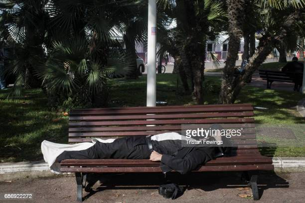 A man rests on a bench during the 70th annual Cannes Film Festival at on May 22 2017 in Cannes France