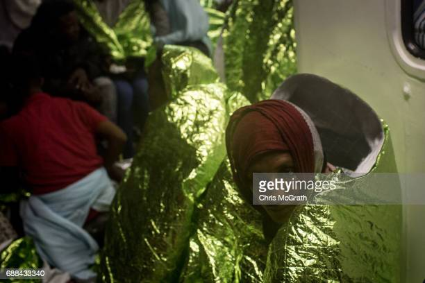 A man rests on board the Migrant Offshore Aid Station 'Phoenix' vessel on May 25 2017 off Lampedusa Italy The crew of the 'Phoenix' rescued 603...