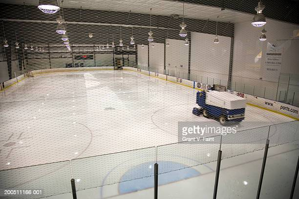 man resurfacing ice at indoor hockey arena - ice hockey rink stock pictures, royalty-free photos & images