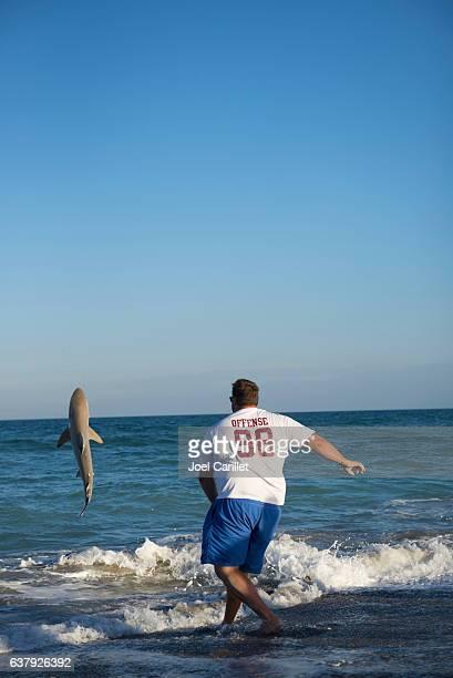 Man returning caught shark to sea in Brevard County, Florida