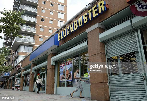 A man returns a rented movie to a Blockbuster store in New York Friday June 18 2004 Viacom Inc the thirdlargest US media company will receive $738...