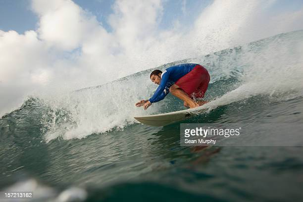 A man ridding a barrel wave in Nicaragua
