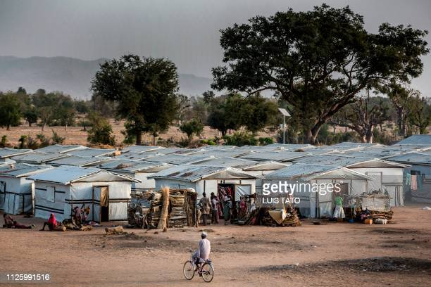 TOPSHOT A man ride a bicycle inside a refugee camp in Jimeta Adamawa State Nigeria on February 19 four days ahead of the country's General elections...