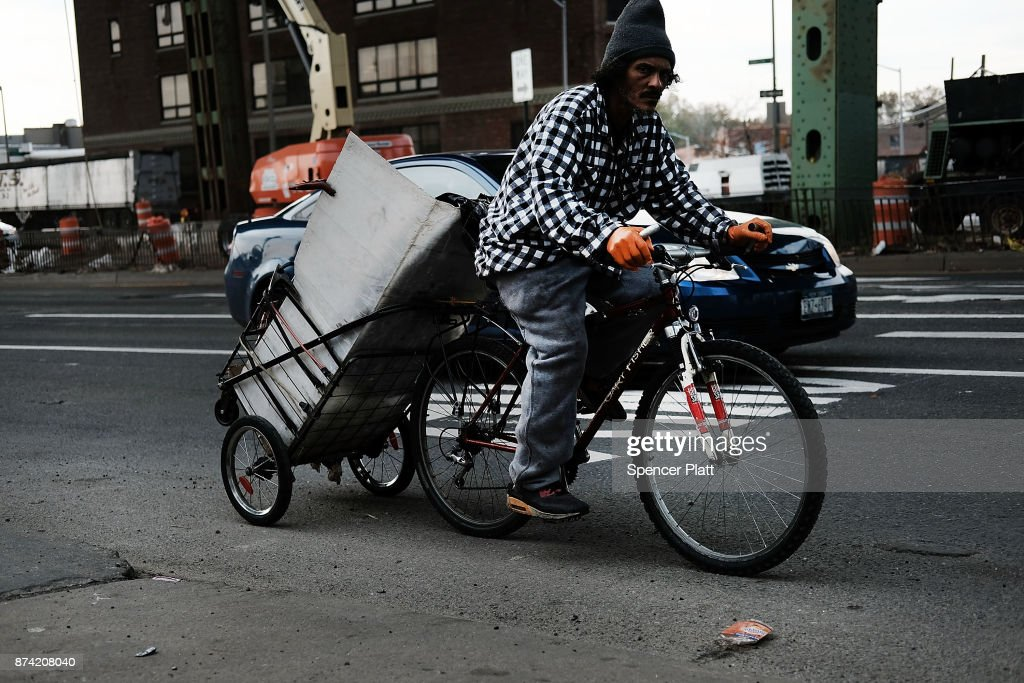 A man rides a bicycle along a busy road on November 14, 2017 in New York City. According to a new report by the International Energy Agency, (IEA) global oil demand will fall only slightly alongside the predicted rise in electric vehicles over the next two decades. In its World Energy Outlook 2018, the Paris-based group expects oil prices should continue to rise towards $83 a barrel by the mid-2020s and that the U.S. will be a dominant force in global oil and gas markets for many years to come. The IEA report also predicts that the world will use just over 100 million barrels of oil a day by 2025.