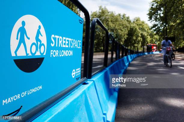 Man rides a bicycle along a section of roadway newly assigned for cyclists and pedestrians, part of the Mayor of London's 'Streetspace' scheme, on...