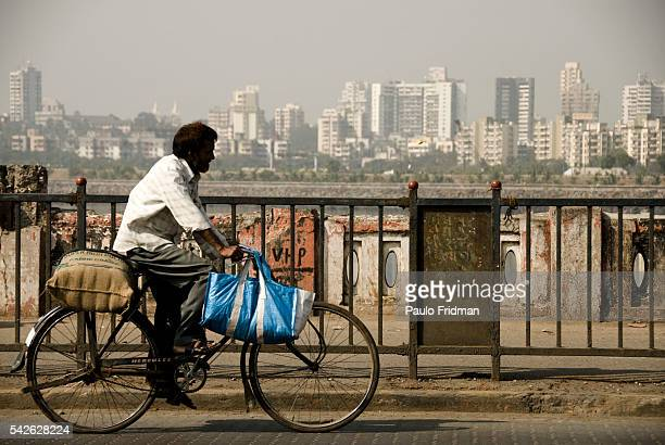 A man rides a bicycle in the metropolitan area of Mumbai Maharastra India