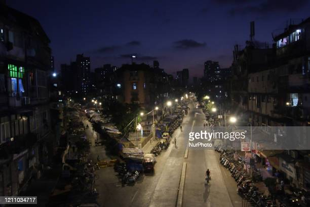 Man rides a bicycle on a nearly empty street in Mumbai, India on April 26, 2020. India continues in nationwide lockdown to control the spread of the...