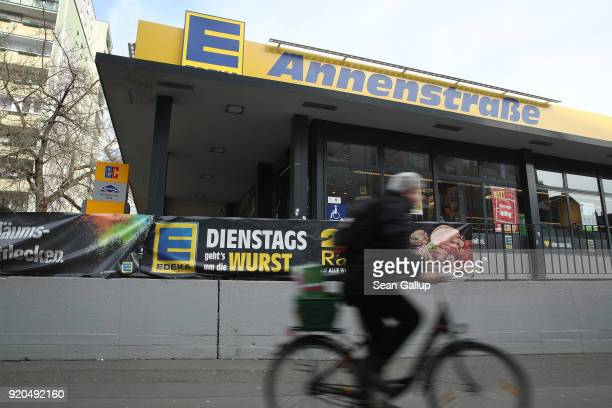 A man rides a bicycle past a grocery store of German chain Edeka on February 19 2018 in Berlin Germany According to media reports AgecoreGroup to...