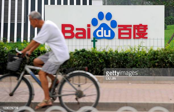 Man rides a bicycle past the logo of Baidu at its headquarter in Beijing on July 22, 2010. Chinese Internet search giant Baidu said its profits more...