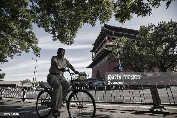 A man rides a bicycle through a traditional hutong neighborhood in Beijing China on Sunday May 14 2017 Chinas economy is staging a comeback as...