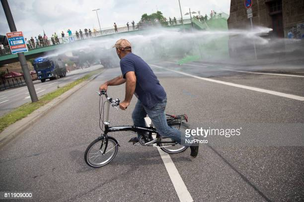 Man rides a bike during G 20 summit in Hamburg on July 7 2017