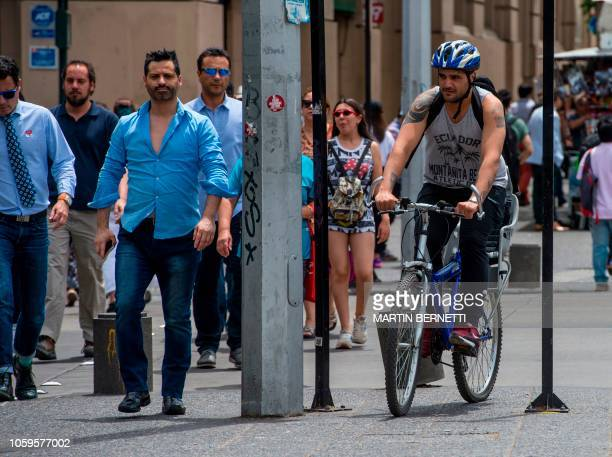 A man rides a bike in a sidewalk of Santiago on November 09 2018 Bicycles scooters and skateboards will have to get off sidewalks and circulate in...