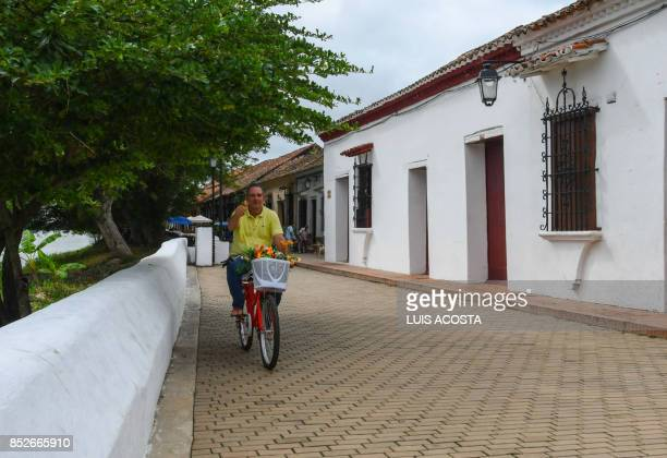 A man rides a bike on a street in Santa Cruz de Mompox Department of Bolivar September 23 2017 the Colombian town on the banks of the great river...