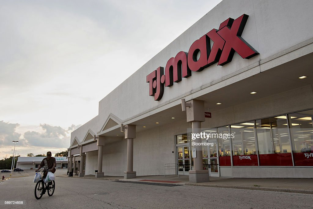 A man rides a bike past a TJ Maxx store in Peoria  Illinois  U S. TJ Maxx  Marshalls  And Home Goods Stores Ahead Of The TJX Cos