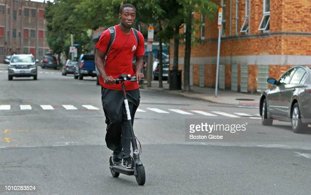 A man rides a Bird Scooter on Pearl Street in Somerville MA on Aug 1 2018 Bird Scooters are dockless electric scooters with an accelerator on one...